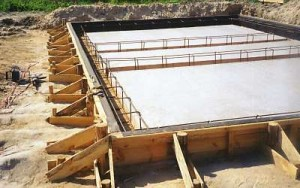 Плитный фундамент для кирпичного дома